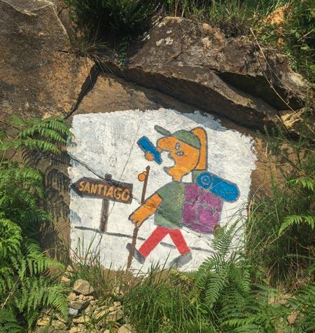 Camino del Norte - San Sebastian nach Zarautz - Gemälde als Wegweiser (hält der Typ ein Handy in der Hand?)